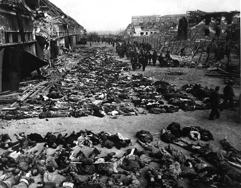 768px Rows of bodies of dead inmates fill the yard of Lager Nordhausen a Gestapo concentration camp - هولوکاست Holocaust